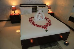 A bed or beds in a room at Menarol Guest House