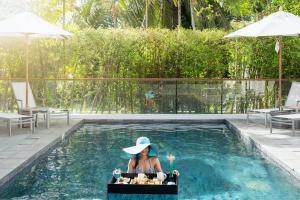 The swimming pool at or close to X2 Vibe Phuket Patong Hotel