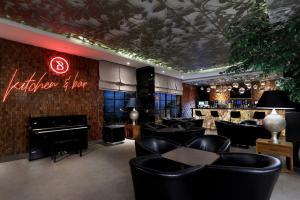 The lounge or bar area at Aston Inn Batu