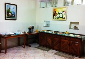 A kitchen or kitchenette at Hotel Perez