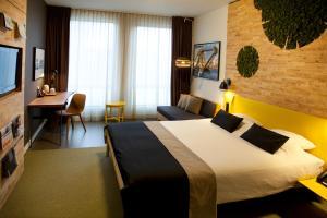 Een bed of bedden in een kamer bij Skotel Amsterdam, Hotelschool The Hague