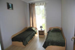 A bed or beds in a room at Aulaukio Baltija