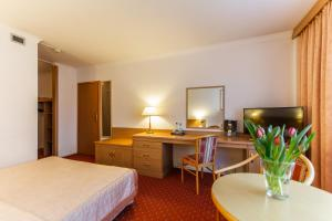A bed or beds in a room at Hotel Solny