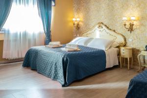 Cama ou camas em um quarto em La Bauta