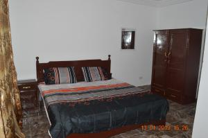 A bed or beds in a room at sukuta nema guest house
