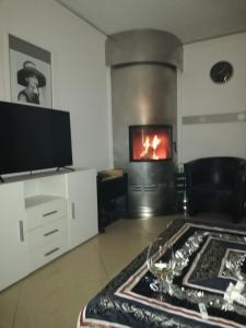 A television and/or entertainment center at Villaci Business Apartments