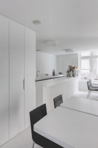 A kitchen or kitchenette at Zenden Hotel Maastricht