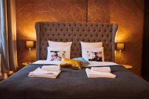 A bed or beds in a room at Royal Route Residence Lesser Town