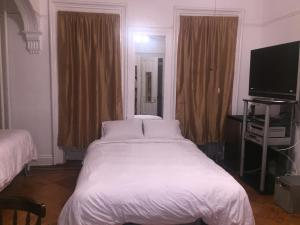 Un ou plusieurs lits dans un hébergement de l'établissement Illumination Bed & Breakfast