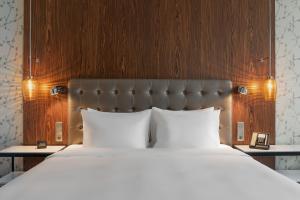 Кровать или кровати в номере Отель Hilton Санкт-Петербург Экспофорум