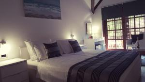 A bed or beds in a room at Villa Ruhige Lage