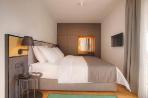 Кровать или кровати в номере Fontana Hotel & Gastronomy