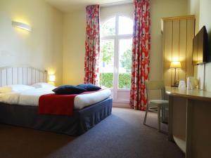 Un ou plusieurs lits dans un hébergement de l'établissement Campanile Val de France