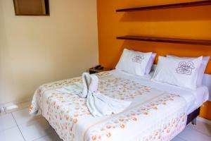 A bed or beds in a room at Hotel Gramado da Serra