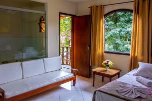 A seating area at Hotel Gramado da Serra