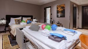 Łóżko lub łóżka w pokoju w obiekcie Clarion Hotel Aviapolis