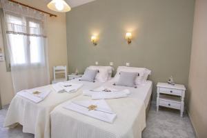 Letto o letti in una camera di Alexandra's Rooms