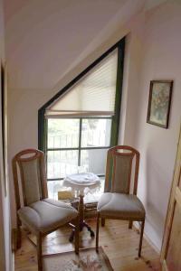 Ein Sitzbereich in der Unterkunft Ferienhof Alte Schmiede