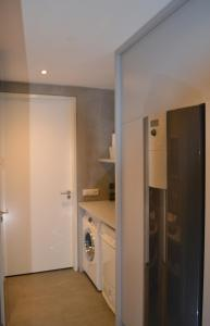 A kitchen or kitchenette at Bed & Breakfast 't Westergouwertje