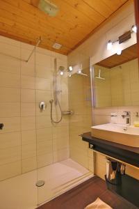 Ein Badezimmer in der Unterkunft Donneralm