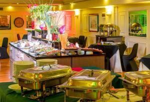 Un restaurante o sitio para comer en Hotel Frontera Clásico