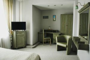 Телевизор и/или развлекательный центр в Отель Шале