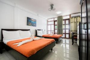 A bed or beds in a room at Deparis Beach Resort