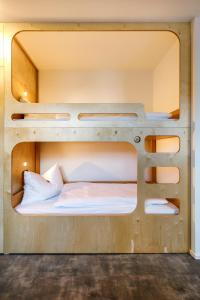 A bunk bed or bunk beds in a room at Jugendherberge Burghausen