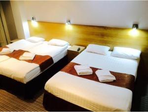 Un ou plusieurs lits dans un hébergement de l'établissement West Cromwell Hotel