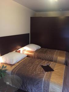 Łóżko lub łóżka w pokoju w obiekcie Camping Motel WOK