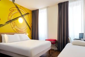 A bed or beds in a room at ibis Styles Marseille Gare Saint-Charles