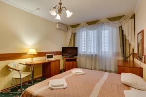 Телевизор и/или развлекательный центр в #23 Orekhovo Apartments near Tsaritsyno Park
