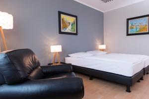 Uma cama ou camas num quarto em City Hotel Berlin East