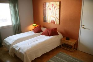 A bed or beds in a room at Villa Prud