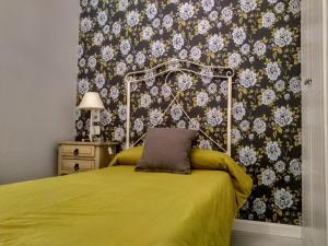 Cama o camas de una habitación en Apartamentos Columela