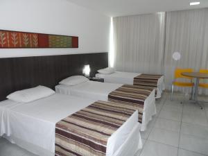 Cama ou camas em um quarto em Cambuci Hotel