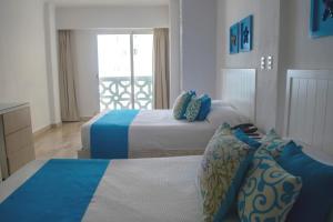 Cama o camas de una habitación en BSEA Cancun Plaza Hotel