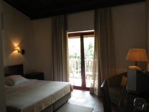 Uma cama ou camas num quarto em Hotel Rural Quinta de Novais