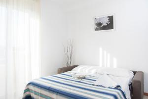 Letto o letti in una camera di Residence Cigno