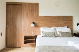 Кровать или кровати в номере Hotel Cabo de la Vela