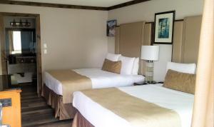 Un ou plusieurs lits dans un hébergement de l'établissement The Dalles Inn