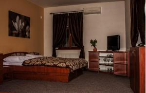 Posteľ alebo postele v izbe v ubytovaní Hotel Pod Hradom