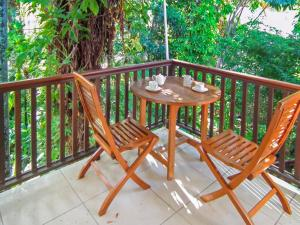 A balcony or terrace at Palm Cove Beach Retreat