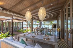 A restaurant or other place to eat at Cape Fahn Hotel Samui - SHA Plus Certified