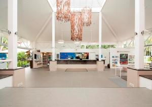 The lobby or reception area at Sonia's At Ramada Resort Free Wifi & 2 Push Bikes