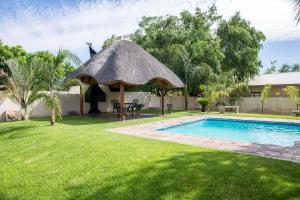 The swimming pool at or near Schroderhuis Guesthouse