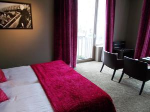 Ein Bett oder Betten in einem Zimmer der Unterkunft The Memlinc