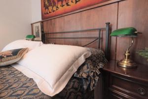 Cama o camas de una habitación en Villino la Magnolia Blue