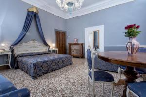 Cama ou camas em um quarto em Hotel Mezzo Pozzo