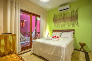 Cama ou camas em um quarto em Raio de Sol Pousada